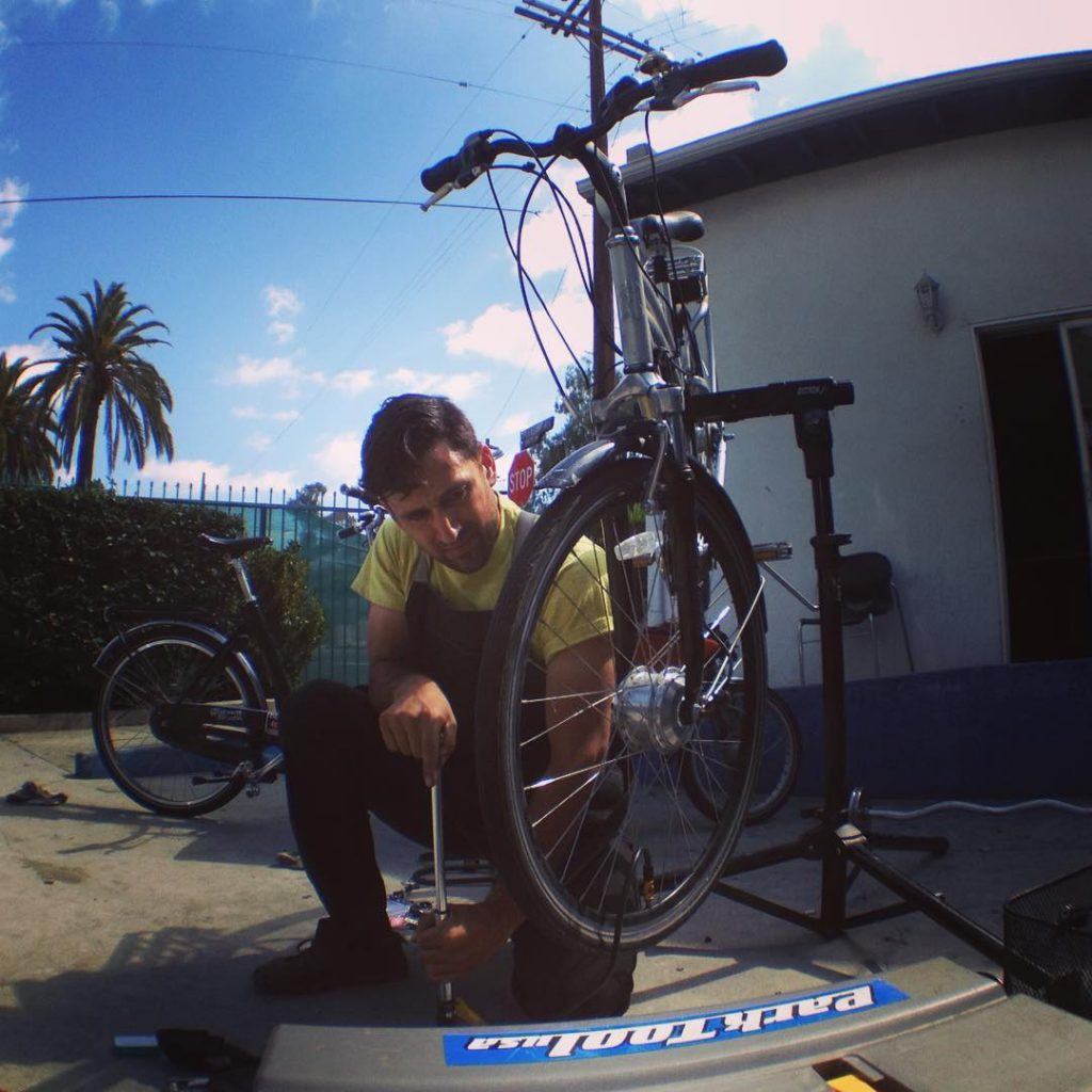 I organized a work party to repair a fleet of bicycles for formerly homeless kids living in transitional housing. Here I am fixing a flat tire on one of their bicycles.